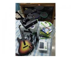 Modified Xbox 360 with accessories drums & guitar